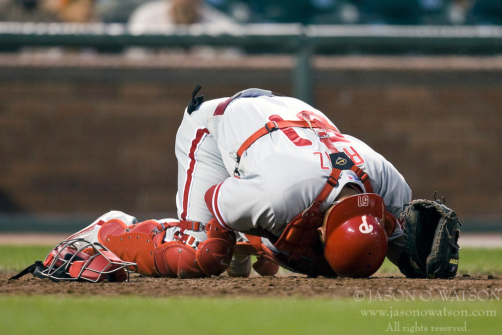April 27, 2010; San Francisco, CA, USA;  Philadelphia Phillies catcher Carlos Ruiz (51) reacts after getting hit in the mask with a pitch during the third inning against the San Francisco Giants at AT&T Park. San Francisco defeated Philadelphia 6-2.