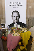 A detail portrait of Apple's creator Steve Jobs at a  makeshift shrine, where Londoners commemorate the morning after hearing of his death overnight from pancreatic cancer  at the age of 56 on the 6th Oct 2011. This Apple Store in the capital's Covent Garden, one of the first to be built in Europe and serves as a flagship outlet for the stylish brand of computer accessories that were largely the brainchild of Jobs who started the company as a student in 1977.