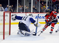 March 7, 2008; Newark, NJ, USA; Tampa Bay Lightning goalie Karri Ramo (31) makes a save on New Jersey Devils right wing Arron Asham (22) during the second period at the Prudential Center in Newark, NJ.