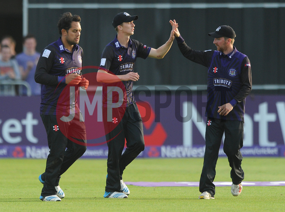Craig Miles of Gloucestershire celebrates catching out Tom Cooper of Somerset for 14 with Tom Smith of Gloucestershire - Photo mandatory by-line: Dougie Allward/JMP - Mobile: 07966 386802 - 19/06/2015 - SPORT - Cricket - Bristol - County Ground - Gloucestershire v Somerset - Natwest T20 Blast