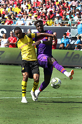 July 22, 2018 - Charlotte, NC, U.S. - CHARLOTTE, NC - JULY 22: Abdou Diallo (4) of Borussia Dortmund and Divock Origi (27) of Liverpool fight for the ball during the International Champions Cup soccer match between Liverpool FC and Borussia Dortmund in Charlotte, N.C. on July 22, 2018.  (Photo by John Byrum/Icon Sportswire) (Credit Image: © John Byrum/Icon SMI via ZUMA Press)
