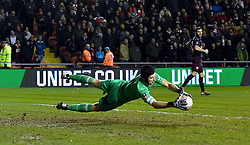 Arsenal goalkeeper Petr Cech saves a shot on goal from Blackpool's Chris Taylor (not in frame) during the Emirates FA Cup, third round match at Bloomfield Road, Blackpool.
