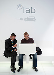 Visitor to Volkswagen stand using eLAB the research and development facility at the Frankfurt Motor Show 2009
