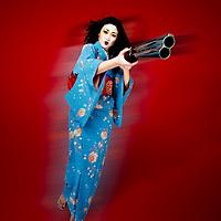 Sexy Japanese woman poses in kimono with shotgun, anime style