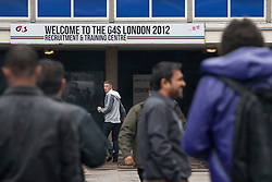 © licensed to London News Pictures. London, UK 14/07/2012. G4S's new recruitments outside the company's Recruitment & Training Centre in Stratford this morning. Photo credit: Tolga Akmen/LNP