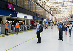 July 26, 2018 - London, London, United Kingdom - South West trains strike. .View of the Waterloo train station this morning...Commuters face chaos as eight days of walkouts begintoday. Workers start to hold the walkouts over a period of six weeks amid a long-running dispute over the role of guards on trains. The reduced service on all lines in and out of Waterloo as London's busiest station looks set to suffer the brunt of the disruption. (Credit Image: © Gustavo Valiente/i-Images via ZUMA Press)
