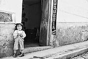 Girl outside barber shop in Sorata, Bolivia...