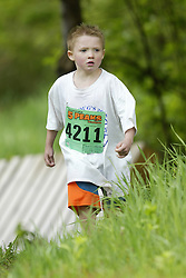 """(Kingston, Ontario---16/05/09) """"Padraig Macdougall running in the kids race at the 2009 Salomon 5 Peaks Trail Running series Race held in Kingston, Ontario as part of the Eastern Ontario/Quebec division. """"  Copyright photograph Sean Burges / Mundo Sport Images, 2009. www.mundosportimages.com / www.msievents.com."""