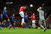 Cristiano Ronaldo scores the second goal during the UEFA Champions League First Knockout Round Second Leg match between Manchester United and Inter Milan at Old Trafford on March 11 2009, in Manchester, England.