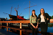 Young girls enjoy the midnight sun in front of a Viking ship replica, anchored at lake Onega. A great mood is in the air as the long, dark and depressing winter has finally ended.
