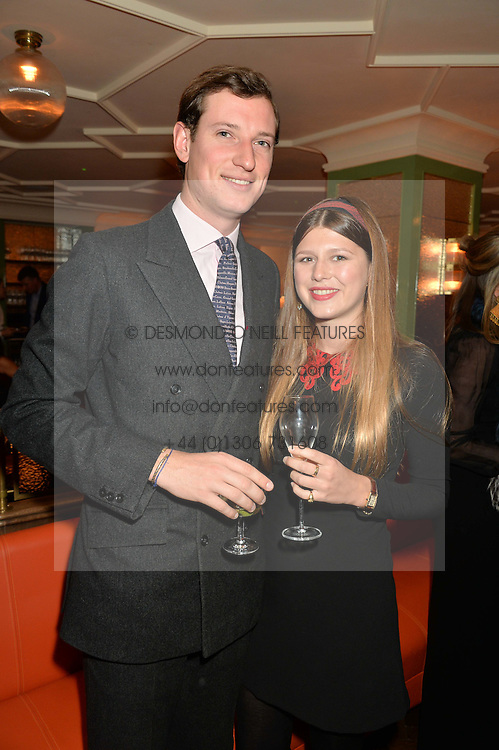 Left to right, FINN BULOW (check spelling) and CORINTHIA PEARSON at a party hosted by Pace Gallery as part of Frieze 2015 held at 45 Jermyn Street, London on 15th October 2015.