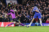 Simon Mignolet of Liverpool (left) saves at the feet of Diego Costa of Chelsea (right) during the Capital One Cup Semi Final 2nd Leg match between Chelsea and Liverpool at Stamford Bridge, London, England on 27 January 2015. Photo by David Horn.