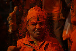 April 15, 2018 - Bhaktapur, Nepal - A Nepalese reveler reacts to vermilion colors during Sindoor festival at Thimi in Bhaktapur, Nepal. Revelers carried chariots of Hindu gods and goddesses and hurled vermillion powder onto each other as part of celebrations commencing Nepalese New Year especially by the ethnic Newar community. (Credit Image: © Skanda Gautam via ZUMA Wire)