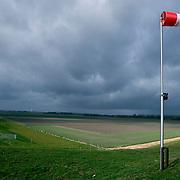 Nederland Flevoland 12 maart 2008 20080312 .Storm windvlag polder Flevoland..Foto David Rozing