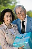 Seniors Holding Gift