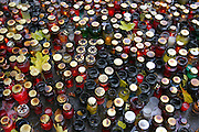 Lodz, Poland cemetery on All Saints Day. Candles in the rain make plinking and sizzling sound when hit by raindrops.