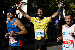 November 13, 2016 - Athens, Attica, Greece - A runner makes a double victory sign to the camera. Thousands of people from all over the world took part in the 2016 Athens Marathon the Authentic, which starts in the town of Marathon and is ending in Athens, the route, which according to legend was first run by the Greek messenger Pheidippides in 490 BC. (Credit Image: © Michael Debets/Pacific Press via ZUMA Wire)