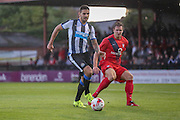 Aleksandar Mitrovic & Dave Winfield during the Pre-Season Friendly match between York City and Newcastle United at Bootham Crescent, York, England on 29 July 2015. Photo by Simon Davies.