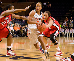Virginia guard Sharnee Zoll (5) dribbles past NC State.  The Virginia Cavaliers defeated the NC State Wolfpack women's basketball team 74-49 at the John Paul Jones Arena in Charlottesville, VA on February 1, 2008.