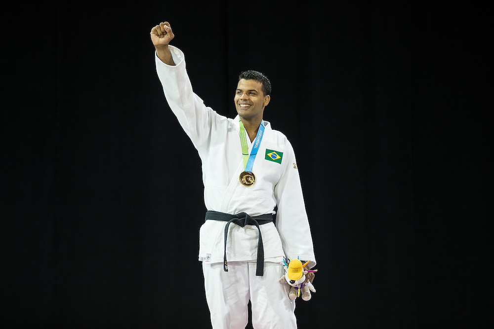 Luciano Correa of Brazil celebrates after receiving his  gold medal in the mens judo -100kg class at the 2015 Pan American Games in Toronto, Canada, July 14,  2015.  AFP PHOTO/GEOFF ROBINS