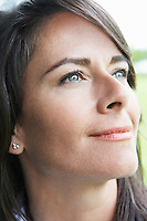 Woman smiling outdoors, close-up