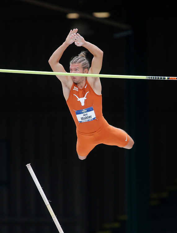 Texas' Wolf Mahler clear the bar while competing in the pole vault during the men's decathlon on the second day of the NCAA outdoors college track and field championships in Eugene, Ore., Thursday, June 8, 2017. (AP Photo/Timothy J. Gonzalez)