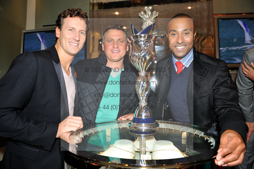 Left to right, BRENDAN COLE, DARREN GOUGH and COLIN JACKSON at a reception to unveil the ISAF World Match Racing Tour Championship Trophy at Garrard, 24 Albemarle Street, London W1 on 7th November 2011.