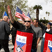 Members of the National Socialist Movement, a Neo Nazi group, led by Southwestern Regional Director Jeff Russell Hall, left with back to crowd, rallies in Claremont, California against illegal immigration. Please contact Todd Bigelow directly with your licensing requests.