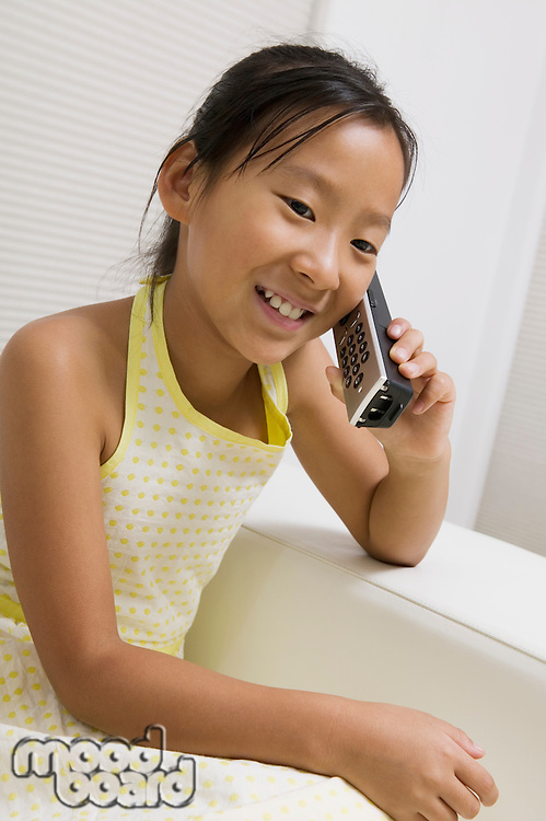 Girl Talking on Cordless Telephone