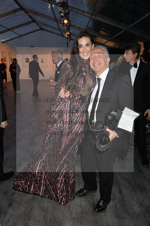 DEMI MOORE and JAMES PELTEKIAN at British Vogue's Centenary Gala Dinner in Kensington Gardens, London on 23rd May 2016.