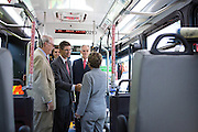 The Silicon Valley Leadership Group CEO, Carl Guardino, updates Sen. Barbara Boxer (D-CA) on the funding and progress of the Berryessa Extension Project in a private VTA Express bus in San Jose, Calif., on Aug. 21, 2012.  Photo by Stan Olszewski/SOSKIphoto.