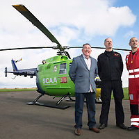 National Air Ambulance Week.. Britain's last Bolkow helicopter air ambulance operated by SCAA prepares to fly into history when it is replaced by EC-135 in November 2015. To mark this Scotland's original Bolkow paramedics gathered at Perth Airport to meet the current crew.<br /> Pictured from left to right Ian Golding who served as a Paramedic on the Bolkow when first introduced to Scotland in 1989, Captain Russell Myles Senior Pilot and current Lead Paramedic John Pritchard<br /> Picture by Graeme Hart.<br /> Copyright Perthshire Picture Agency<br /> Tel: 01738 623350  Mobile: 07990 594431