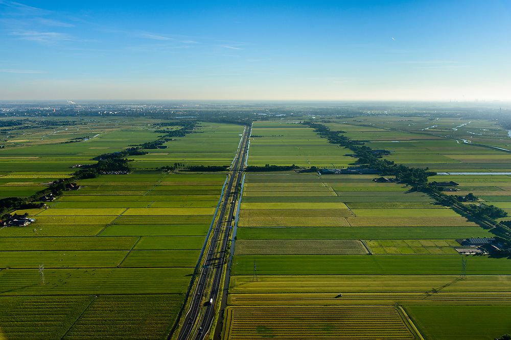 Nederland, Noord-Holland, Gemeente Purmerend, 13-06-2017; polder Wijdewormer, droogmakerij uit de 17e eeuw. Autosnelweg A7 doorsnijdt het gebied.<br /> Wijdewormer polder, reclaimed land dating from the 17th century. The original landscape has been affected by the construction of motorway A7.<br /> luchtfoto (toeslag op standard tarieven);<br /> aerial photo (additional fee required);<br /> copyright foto/photo Siebe Swart