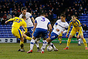 Marcus Forss of Wimbledon has a shot blocked by Kieron Morris of Tranmere Rovers  during the EFL Sky Bet League 1 match between Tranmere Rovers and AFC Wimbledon at Prenton Park, Birkenhead, England on 21 December 2019.