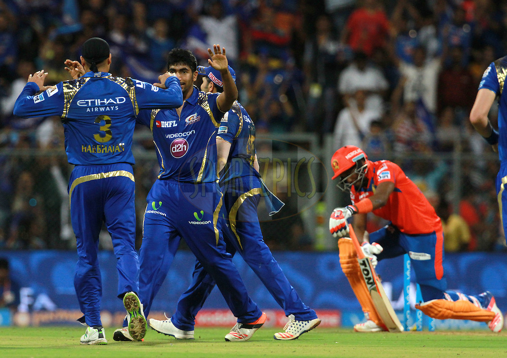 Mumbai Indians player Jasprit Bumrah celebrates the wicket of Gujarat Lions player Dwayne Bravo during match 9 of the Vivo Indian Premier League ( IPL ) 2016 between the Mumbai Indians and the Gujarat Lions held at the Wankhede Stadium in Mumbai on the 16th April 2016<br /> <br /> Photo by Vipin Pawar/ IPL/ SPORTZPICS