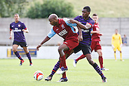 Picture by David Horn/Focus Images Ltd. 07545 970036.04/08/12.Barry Hayles (right) of Chesham United shields the ball from Elton Monteiro of Arsenal during a friendly match at The Meadow, Chesham.