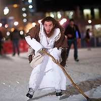 "Using his walking staff as a makeshift hockey stick, Michael Grant, 28, ""Philly Jesus,"" skates at Rothman Ice Rink in Philadelphia, PA on December 14, 2014.  Nearly everyday for the last 8 months, Grant has dressed as Jesus Christ, and walked the streets of Philadelphia to share the Christian gospel by example.  He quickly acquired the nickname of ""Philly Jesus,"" which he has gone by ever since. REUTERS/Mark Makela (UNITED STATES)"