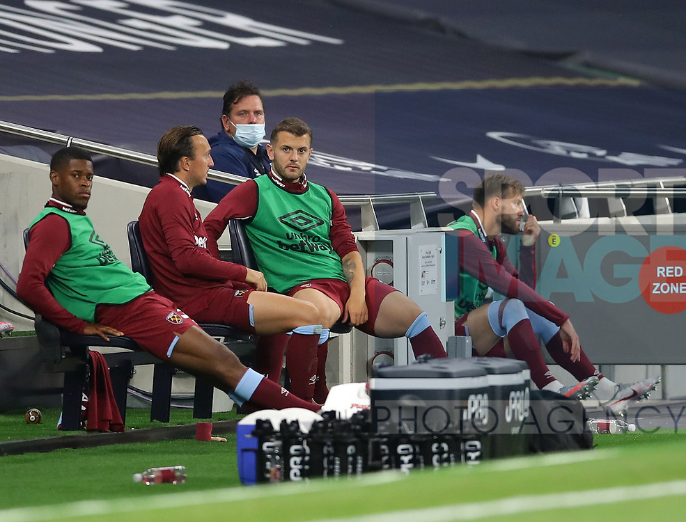 West Ham's Jack Wilshere looks on from the bench during the Premier League match at the Tottenham Hotspur Stadium, London. Picture date: 23rd June 2020. Picture credit should read: David Klein/Sportimage