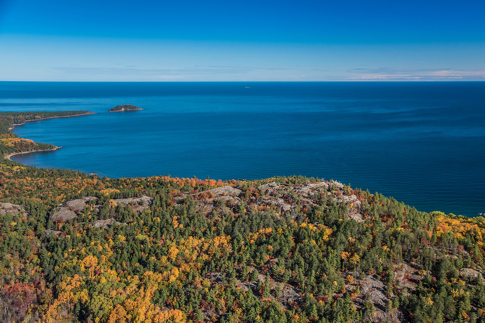 Aerial photography of  the rugged Lake Superior shoreline north of Marquette, Michigan during fall color season. Areas shown include Sugarloaf Mountain lookout, Wetmore Landing Beach and Little Presque Isle.