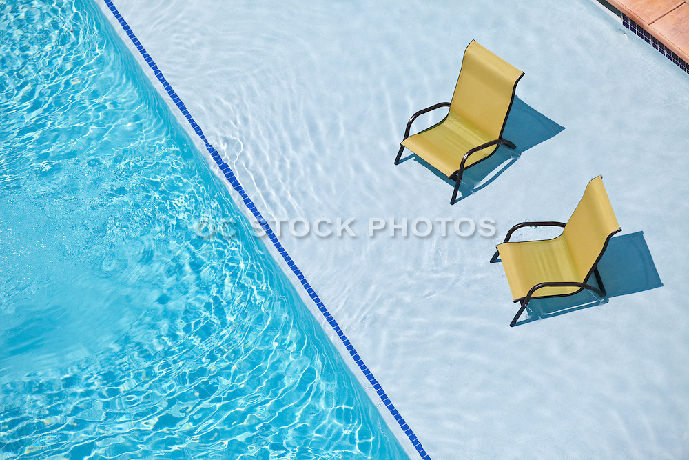 Lounge Chairs At Poolside