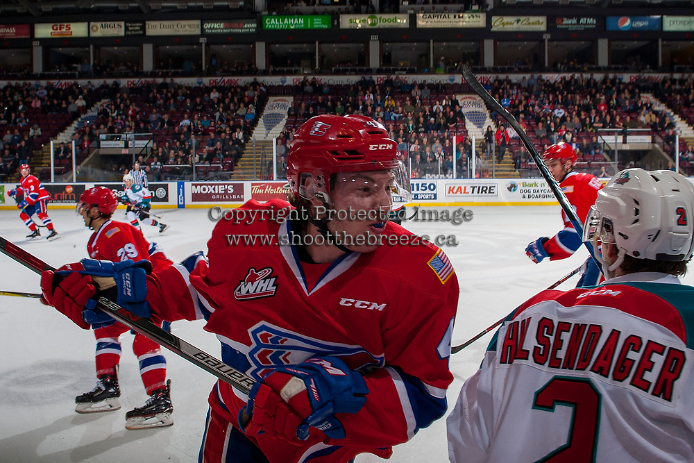 KELOWNA, CANADA - JANUARY 10: Jeff Faith #4 of the Spokane Chiefs comes in for the check on James Hilsendager #2 of the Kelowna Rockets on January 10, 2017 at Prospera Place in Kelowna, British Columbia, Canada.  (Photo by Marissa Baecker/Shoot the Breeze)  *** Local Caption ***