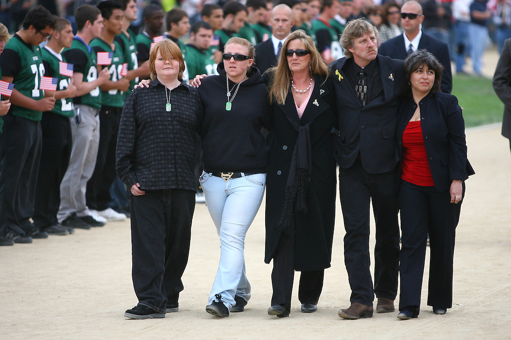 "TORRANCE, CA - JUNE 1: The family of Cpl. Joseph Anzack, Jr., including father Joseph Anzack Sr., walks behind a horse drawn carriage bringing the coffin of Cpl. Joseph Anzack, Jr. to his memorial service at South High School where he graduated in 2005 on June 1, 2007 in Torrance, California. Anzack went missing with two other soldiers when their combat team was ambushed on May 12 near Mahmoudiya, south of Baghdad, Iraq. Al Qaeda claimed responsibility for the attack which killed four other U.S. soldiers and an Iraqi interpreter. Two American soldiers remain missing. Earlier this year, his family breathed a sigh of relief after learning that the rumors of his death which prompted South High School students to post a message on the school marquee reading, ""In Loving Memory - Joseph Anzack - Class of 2005"", turned out to be false. Anzack will be interred at Arlington National Cemetery."