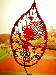 January 11, 2017 - Qingdao, Qingdao, China - Qingdao, CHINA-January 11 2017: (EDITORIAL USE ONLY. CHINA OUT) ..The leaf carving artwork 'Little Mermaid' made by the primary school teacher Wang Ping in Qingdao, east China's Shandong Province, January 11th, 2017. Wang Ping collected various leaves in spare time and made many beautiful artworks of leaf carving in the way of paper-cutting. Natural leaf carving is actual manual cutting and removal of a leaf's surface to produce an art work on a leaf. (Credit Image: © SIPA Asia via ZUMA Wire)