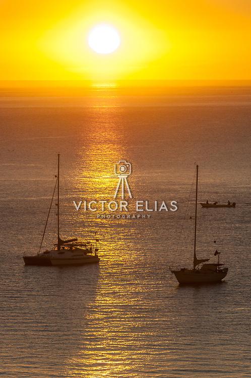 Sunrise with sailboats at Cabo San Lucas Bay.