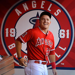 Los Angeles Angels' Mike Trout smiles on his birthday prior to a baseball game against the Los Angeles Dodgers at Anaheim Stadium in Anaheim, Calif., on Thursday, Aug. 7, 2014.