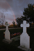 A rainbow appears in the horizon behind the grave of Sr. Marie Adele Brise at the Chapel of Our Lady of Good Help in Robinsonville, Wis., located about 20 miles north of Green Bay. A chapel was built on the grounds in 1861, the site where Sr. Adele reportedly experienced an apparition of the Blessed Mother. While the Green Bay Diocese has never given recognition of the apparition, it has sanctioned the chapel as a place of worship. (Green Bay Compass photo by Sam Lucero)