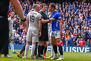 Nikola Katic of Rangers FC gets to his feet and confronts Lewis Ferguson of Aberdeen FC during the Ladbrokes Scottish Premiership match between Rangers and Aberdeen at Ibrox, Glasgow, Scotland on 27 April 2019.
