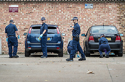 © Licensed to London News Pictures. 05/09/2017. London, UK. Police conduct a fingertip search in the road where two teenage boys were shot and injured yesterday in Forest Gate, Newham. Police were called at 15:10 hrs and found two teenage boys - aged 14  and 17 with gunshot injuries. Photo credit: Peter Macdiarmid/LNP