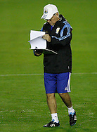 Argentina manager Alejandro Sabella checks his notes during the Argentina training session at the Est&aacute;dio S&atilde;o Janu&aacute;rio, Rio de Janeiro, ahead of tomorrow's World Cup Final.<br /> Picture by Andrew Tobin/Focus Images Ltd +44 7710 761829<br /> 12/07/2014