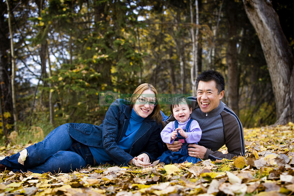 July 21, 2019 - Portrait Of Family Sitting In Leaves (Credit Image: © Richard Wear/Design Pics via ZUMA Wire)